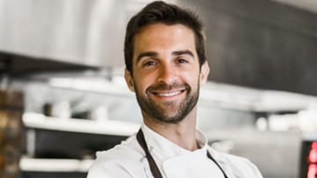 Chef in kitchen smiling